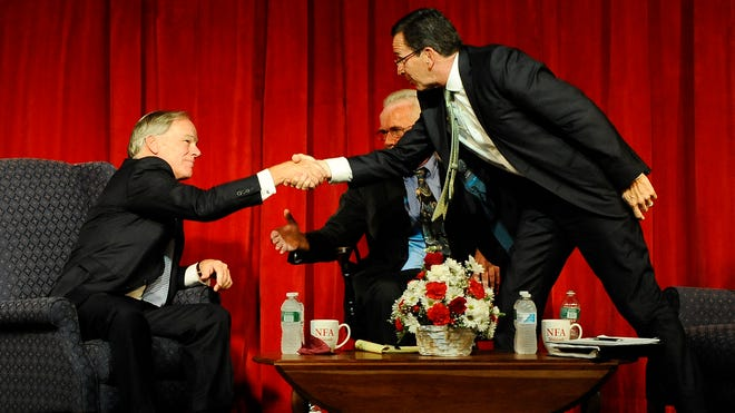 Republican gubernatorial candidate Tom Foley, left, shakes hands with Democratic Gov. Dannel Malloy, right, at the end of a debate on Aug. 27, 2014, in Norwich, Conn.