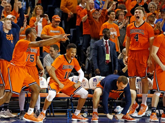 Players on the Bucknell bench celebrate after winning