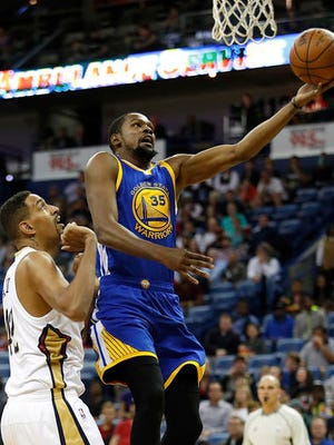 Golden State Warriors forward Kevin Durant (35) shoots over New Orleans Pelicans center Alexis Aijinca (42) in the first half of an NBA basketball game in New Orleans, Tuesday, Dec. 13, 2016.