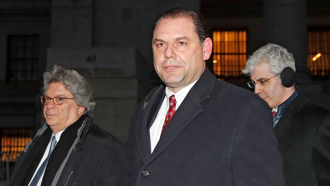 Joseph Percoco, center, one of Gov, Andrew Cuomo's former executive deputy secretary, leaves U.S. District court with attorney Barry Bohrer, left, and others, after appearing in his federal bribery trial, Thursday, Feb. 1, 2018, in New York.