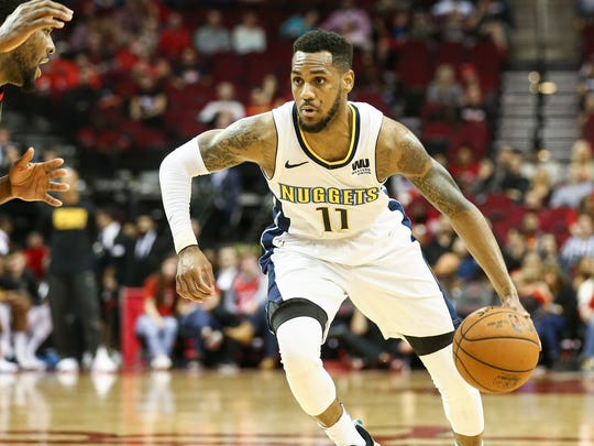 Denver Nuggets guard Monte Morris (11) dribbles the ball during a game against the Houston Rockets at Toyota Center.