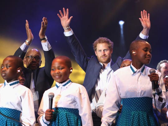Prince Seeiso of Lesotho and Prince Harry on stage