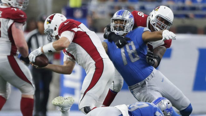 Lions defensive end Jeremiah Valoaga (78) pressures Cardinals QB Carson Palmer in the third quarter of the Lions' 35-23 win Sunday, Sept. 10, 2017 at Ford Field.