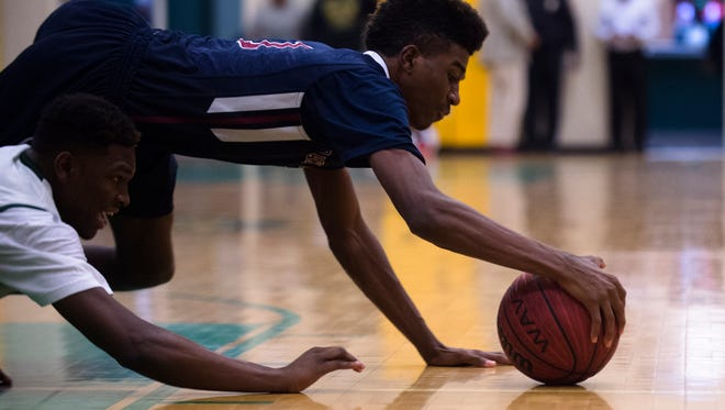 Park Crossing's Titus Sizemore (1) dives on a ball during the game on Friday, Feb. 12, 2016, at Carver High School in Montgomery, Ala.
