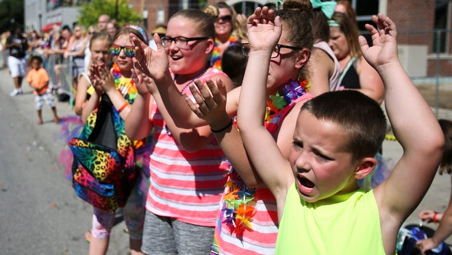 Children clap and cheer during the  Circle City IN Pride Parade on June 11, 2016, in Downtown Indianapolis.