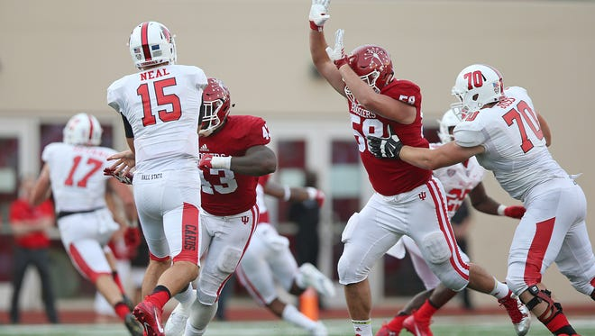 A pass by Ball State Cardinals quarterback Riley Neal (15) is incomplete during fourth quarter action at Indiana University's Memorial Stadium, Bloomington, Ind., Saturday, September 10, 2016. The Hoosiers beat the Cardinals, 30-20.