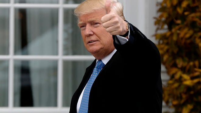 President-elect Donald Trump gives the thumbs up as he arrives at the Trump National Golf Club Bedminster clubhouse, Sunday, Nov. 20, 2016 in Bedminster, N.J..