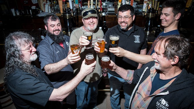 Local beer brewers representing Elm Street Brewing Co., Wolves Head Brewing Co., The Guardian Brewing Co. and New Corner Brewing Co. gather at The Fickle Peach, a supporter of Muncie Brewfest, in Muncie Friday afternoon.