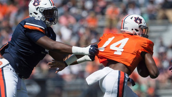 Auburn defensive lineman Derrick Brown (5) sacks Auburn quarterback Malik Willis (14) during Auburn's A-Day on Saturday, April 8, 2017, at Jordan Hare Stadium in Auburn, Ala.