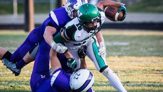 Yorktown's Christian Hunt fights for yards against Central's defense during their game at Central Friday, Aug. 25, 2017.