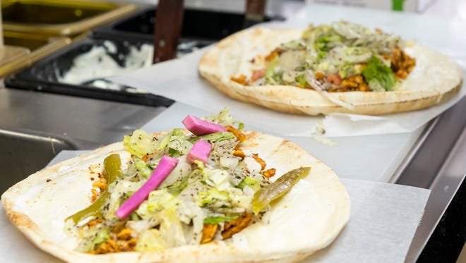 Chicken shawarmas being prepared at Cedar Sub and Salad Oct. 23. The restaurant, at 420 Huron Ave. in Port Huron, is now open.