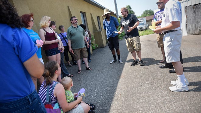 Organizer Justin Michael speaks following a meeting of the Central Minnesota Cares campaign Friday, June 29, in St. Cloud.