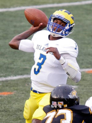 Delaware quarterback Joe Walker throws in the fourth quarter of the Blue Hens' 19-0 loss to Towson Saturday.