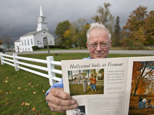 """David Linck of the Craftsbury Historical Society holds a copy of Vermont Life with an article describing the filming of Alfred Hitchcock's """"The Trouble with Harry"""" in 1954 in Craftsbury.  He is seen on Craftsbury Common with the United Church in the background, mirroring the photograph of Hitchcock (left) with John Forsythe and Shirley MacLaine, on Monday, October 7,  2013."""