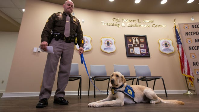 Master corporal Chris Gigliotti will work with Nikko, New Castle County police's new facility assistance dog.