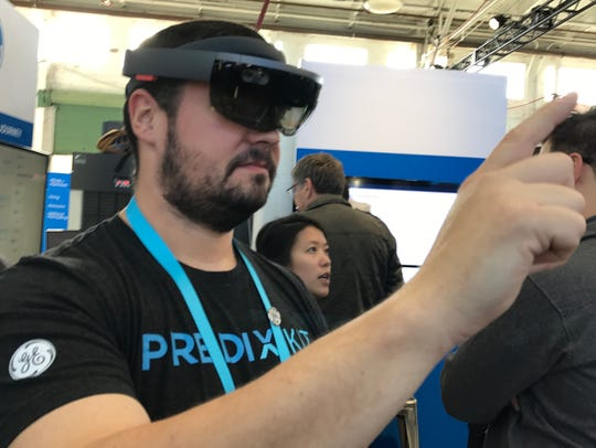 GE Digital's Peter Hardwick wears Microsoft HoloLens,