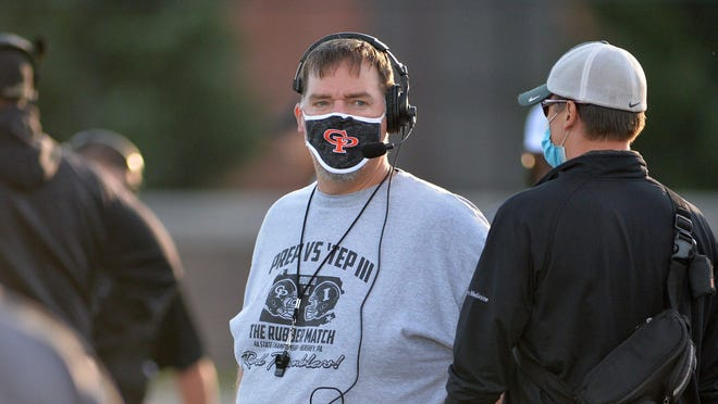 Cathedral Prep football coach Mike Mischler, center, wears a mask as his team scrimmages North Allegheny at Dollinger Field on Sept. 4. This will be a common scene on District 10 sidelines as the season opens during the COVID-19 pandemic.