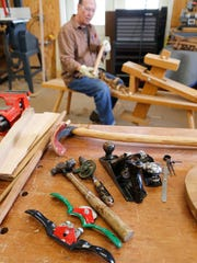 A variety of woodworking tools are at his disposal