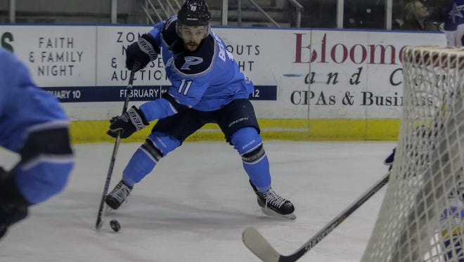 Pensacola's Louis Belisle (11) makes a quick move to pull the puck back in before heading to the Roanoke net Sunday afternoon at the Pensacola Bay Center.