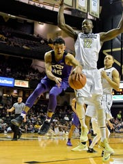 TCU guard Alex Robinson (25) passes around Vanderbilt