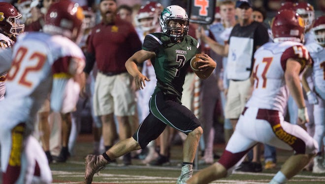 Fossil Ridge quarterback Tanner Hoke tries to find a way through Lobos defense during a game against Rocky Mountain High School at French Field on Friday, September 8, 2017.