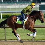 Exercise rider Faustian Aguilar works out Kentucky Derby hopeful Keen Ice trained by Dale Romans at Churchill Downs.