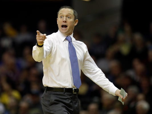 "FILE - This Feb. 17, 2018 file photo shows Florida head coach Mike White yelling to his players in the first half of an NCAA college basketball game against Vanderbilt in Nashville, Tenn. White has a forbidden phrase for his staff. No one is allowed to say ""PK80"" in front of the team. Mentioning the late-November tournament in Portland, Oregon is banned in scouting breakdowns, video sessions and practices. White's new directive has coincided with the start of Florida's turnaround. The No. 23 Gators are ranked after winning three in a row. Florida is playing its best basketball heading into the postseason. (AP Photo/Mark Humphrey, file)"
