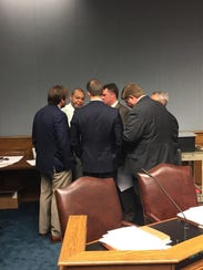 Members of the House Ways and Means Committee huddle
