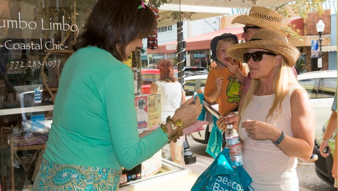 Stuart Stroll participants visit Patty O'Connell at Gumbo Limbo Coastal Chic at the Spring Stuart Stroll.