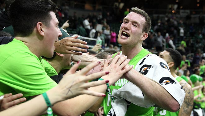 Michigan State forward Matt Costello celebrates with fans after defeating the Maryland Terrapins at the Breslin Center.