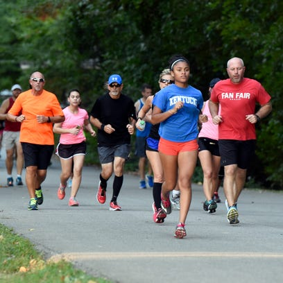 Members of Team 13 run through Wesselman Park in Evansville