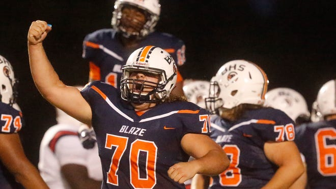 Blackman's Mason Griffith celebrates Master Teague's  (33) touchdown against Oakland during the game, on Friday, Sept. 22, 2017, at Blackman.