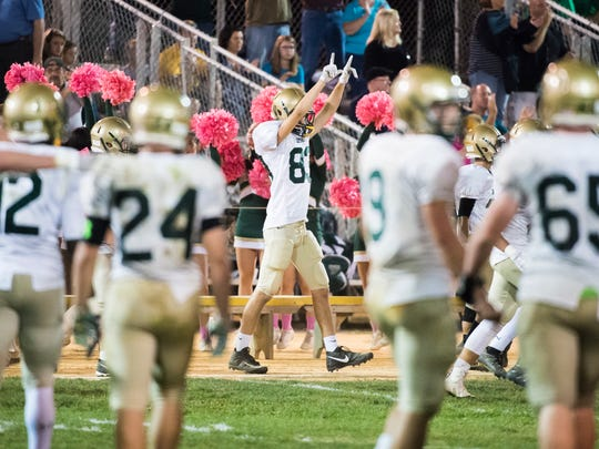 York Catholic's Jack Griffin (center) celebrates after