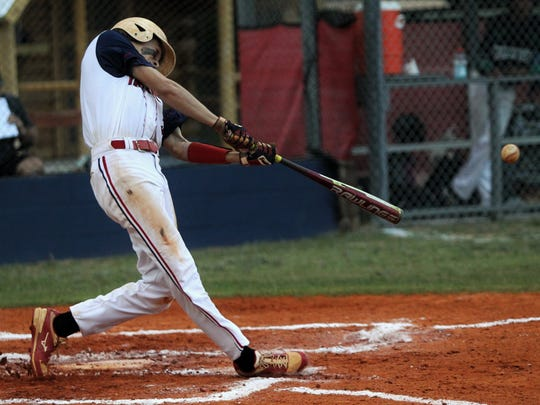 Wakulla Christian's Destin Todd hits a two-run home run in the second inning against Eagle's View.