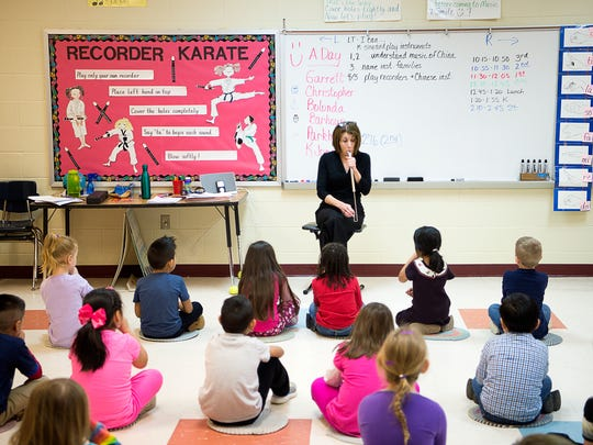 Music teacher Julie Ledford uses a whistle to produce a series of pitches while students recite it back during a music lesson recently at Fletcher Elementary School. School officials say a coming limit on class size in early grades would result in less instruction in subjects like art, music and physical education.