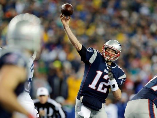In this photo taken Sunday, New England Patriots quarterback