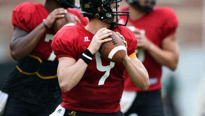 Southern Miss quarterback Nick Mullens practices his throws with the other quarterbacks during the fall football camp on Wednesday.