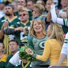 Fans dance to 'Roll Out The Barrel' in the fourth quarter. The Green Bay Packers defeated the New York Jets 31-24 at Lambeau Field on Sunday, Sept. 14, 2014.
