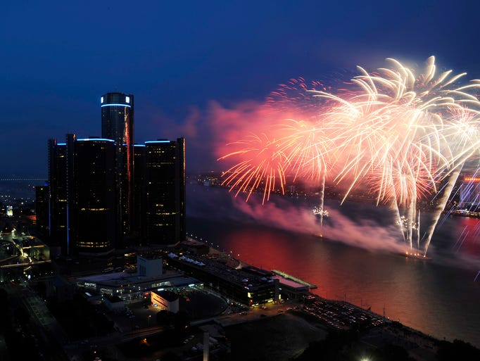 The Ford Fireworks cast a reflection on the Detroit