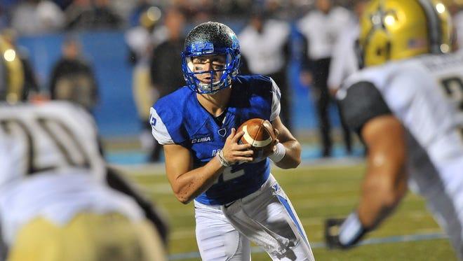 "MTSU Blue Raiders quarterback Brent Stockstill (12) scrambles against the Vanderbilt Commodores in the first half at Johnny ""Red"" Floyd Stadium."