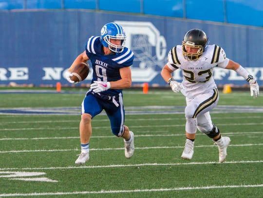 Dixie wide receiver Hobbs Nyberg (9) runs towards the