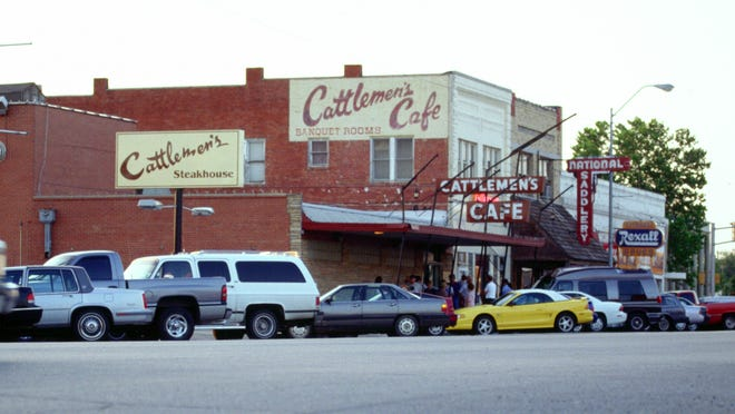 Signs at the exterior of Cattlemen's Steakhouse in Oklahoma City. Two of the signs reflect the restaurant's original name, the Cattlemen's Cafe, which first opened in 1910, and is known for quality beef.