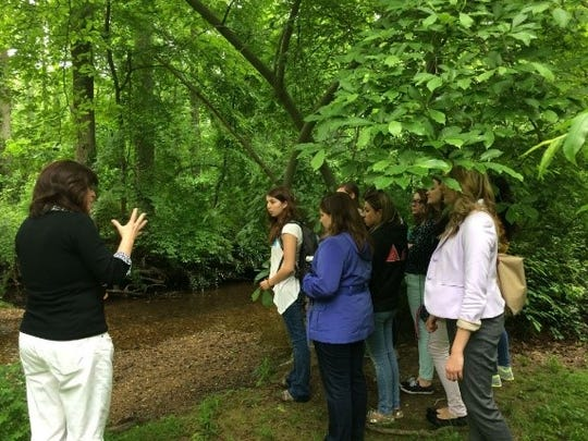 The College of New Jersey students learning how to connect learning to local environments.