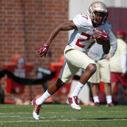 FSU's Marquez White takes off for a run during a spring