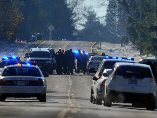 Ohio Highway Patrol Troopers, Fairfield County Sheriff's Deputies and Lithopolis Police Officers investigate the scene of a hit and run crash on the morning of Nov. 13, 2013, that killed Josh Barnes.