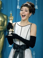 Surprise! Marisa Tomei with her Academy Award.