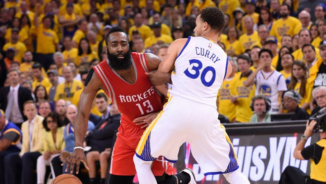 Houston Rockets guard James Harden (13) dribbles as Golden State Warriors guard Stephen Curry (30) defends during the first half in game five of the Western Conference Finals of the NBA Playoffs. at Oracle Arena on May 27, 2015.