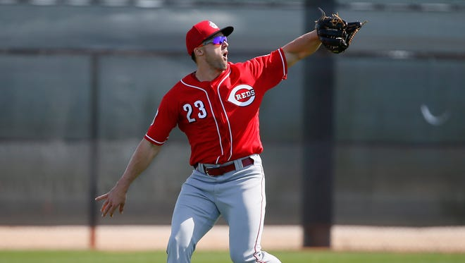 Cincinnati Reds infielder/outfielder Adam Duvall (23) catches a fly ball during drills at Cincinnati Reds spring training, Tuesday, Feb. 23, 2016, in Goodyear, Arizona.