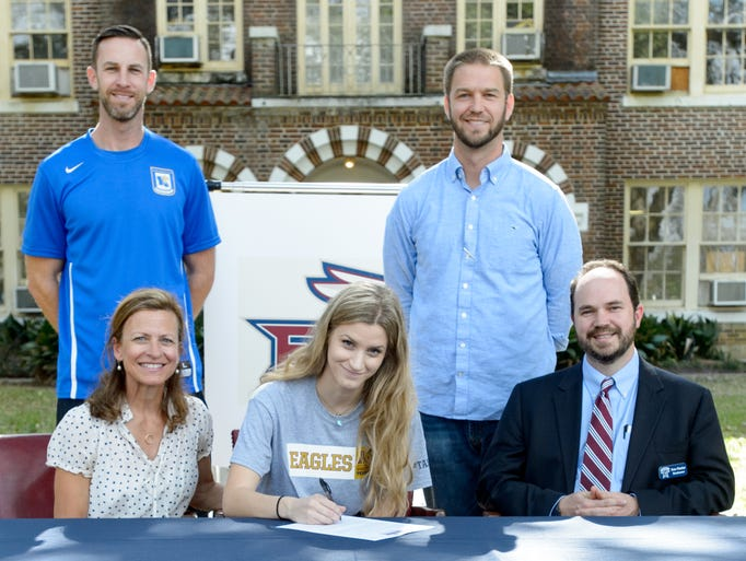 Claire DeClouet signs letter to attend and play soccer