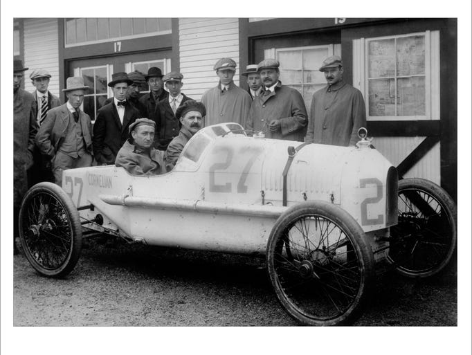 Right to left Gaston, Arthur Chevrolet and Louis Chevrolet behind wheel in car 1915.  Louis Chevrolet  drove in the 1915 race in this Cornelian car #27 starting 23rd and finishing 20th. Next to the driver is his riding mechanician. All three Chevrolet brothers shown have mustaches.